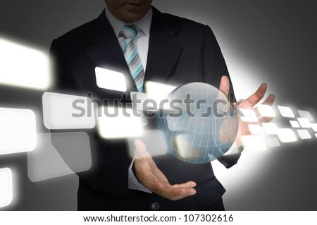 Business Man holding earth globe and flying data.  Elements of this image furnished by NASA. - stock photo
