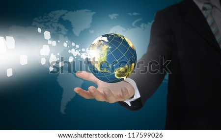 Business Man Holding Earth globe with digital Data.  Elements of this image furnished by NASA - stock photo