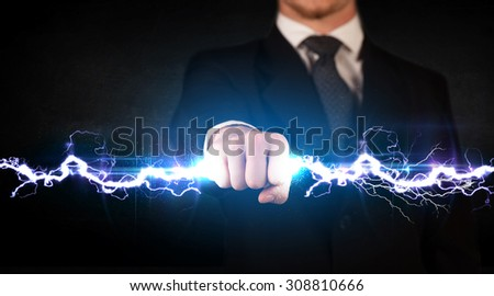 Business man holding electricity light bolt in his hands concept - stock photo