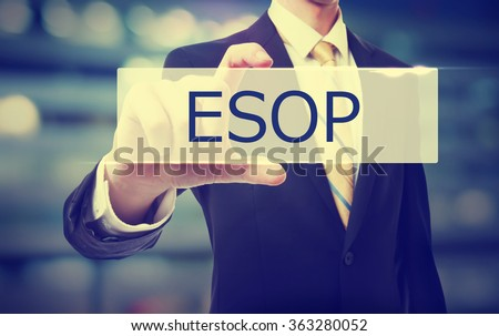 Business man holding ESOP on blurred abstract background   - stock photo