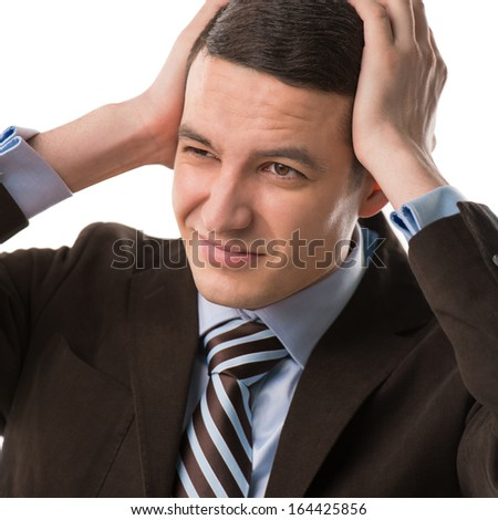 Business man holding his head. Headache or office rush concept - stock photo