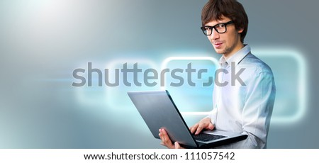 Business man holding laptop and working with virtual interface. Merge of technologies concept - stock photo