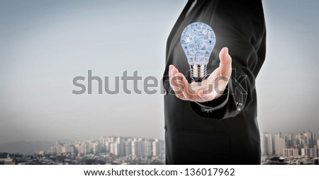 Business man holding light bulb with business concept  inside - stock photo