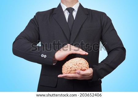business man holding shield Intellectual property protection law and rights  copyright and patents concept protect business ideas and headhunter concepts - stock photo