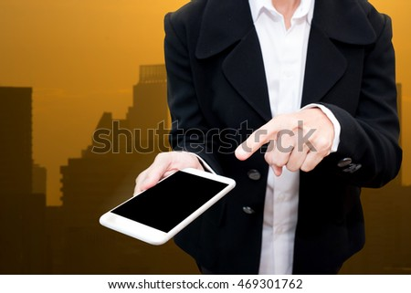 business man holding smart phone with city light picture in background