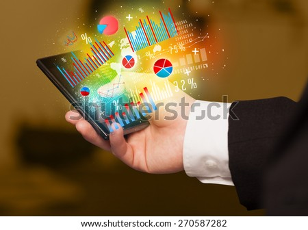 Business man holding smartphone with chart symbols concept