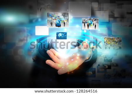 Business man holding social media - stock photo