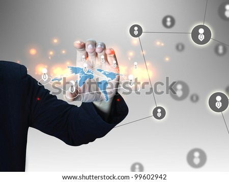 Business man holding social network - stock photo