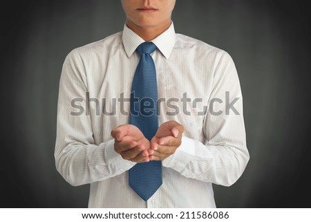 business man holding something on his hand - stock photo