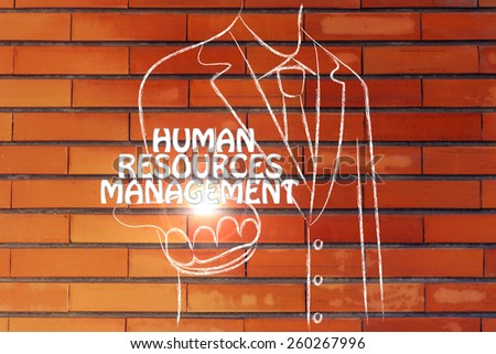 business man holding the word Human Resources Management - stock photo