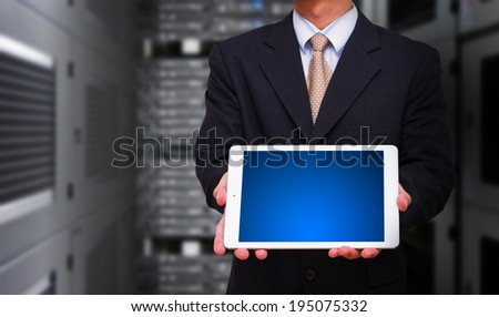 Business man holding touch pad - stock photo