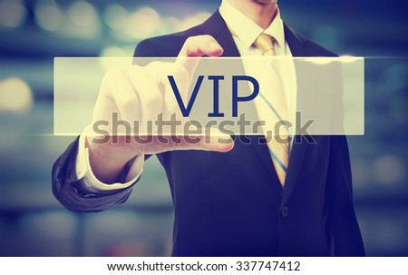 Business man holding VIP on blurred abstract background