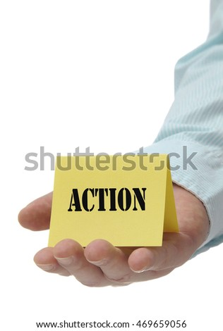 Business man holding yellow action sign on hand