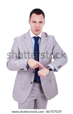 Business man impatiently pointing to his watch. Isolated on white. - stock photo