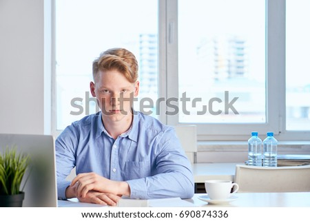 Business man in a blue shirt working at the office