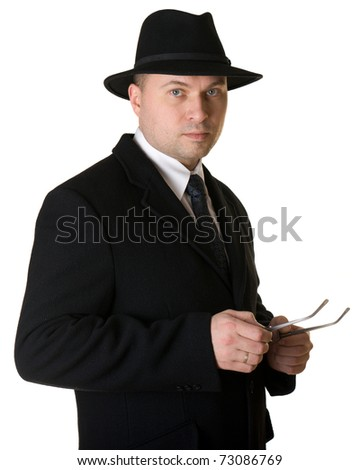 Business man in a hat and coat - stock photo