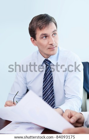Business man in a shirt in the office - stock photo