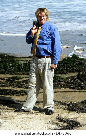 Business man in a suit on the beach