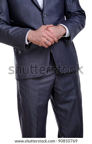 Business man in a suit standing with his hands holding