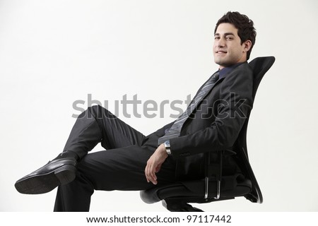 Business man in black office chair - stock photo
