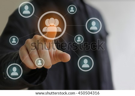 Business man in black pressing Social network icon