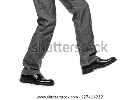 Business man in black shoes walking for next achievement or promotion step white isolated - stock photo