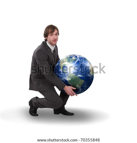 business man in black suit with a model of pour planet - stock photo