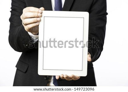 Business man in black suit with shows his blank tablet computer, isolated on white background