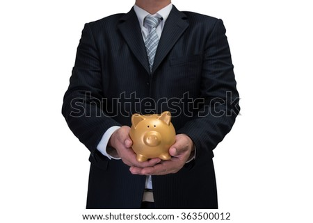 business man in black suite with gold piggy bank isolated on white background