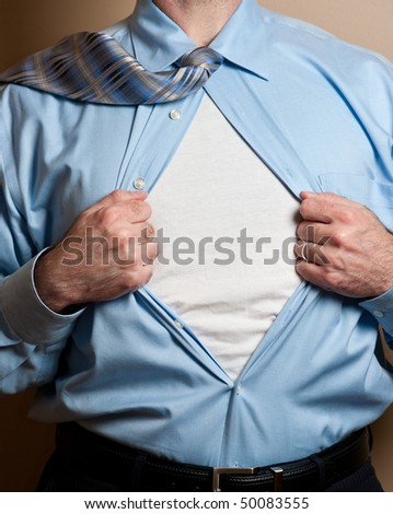 Business man in blue dress shirt and tie opens shirt to reveal blank white undershirt. Blank area suitable for your logo or text.