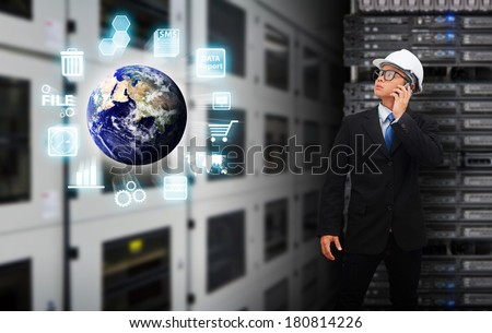 Business man in data center room : Elements of this image furnished by NASA  - stock photo