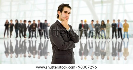 business man in front of a group of people - stock photo