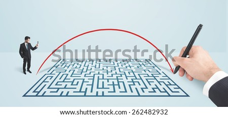 Business man in front of hand drawn maze thinking how to get through - stock photo