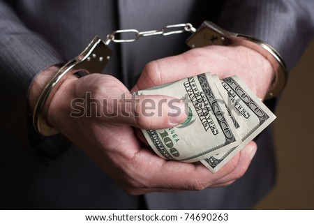 Business man in handcuffs arrested for bribe
