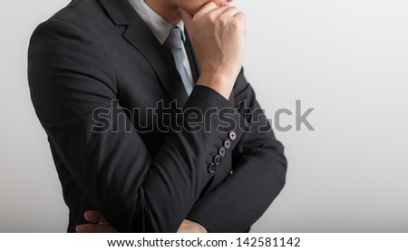 business man in modern elegant suit standing back, isolated over white background. Concept of idea, - stock photo