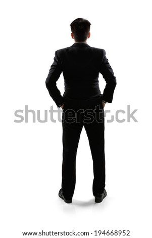 Business man in rear view full length portrait, Isolated over white - stock photo