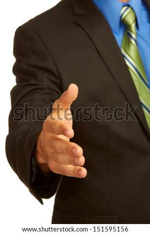 business man in suit offering a handshake isolated on white background. - stock photo