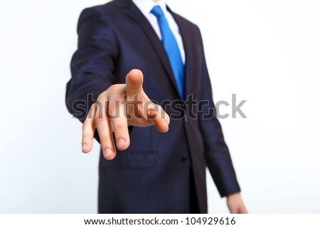 Business man in suit pushing a button with his finger - stock photo