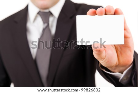 business man in suit showing his business card - stock photo
