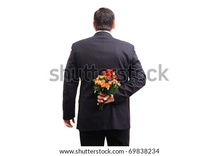 Business man in suit with flowers - stock photo