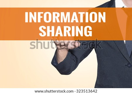 Business man Information Sharing word touch on virtual screen orange background - stock photo
