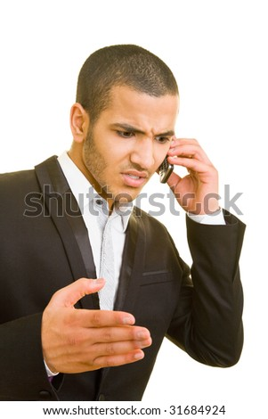 Business man is angry on his cell phone - stock photo