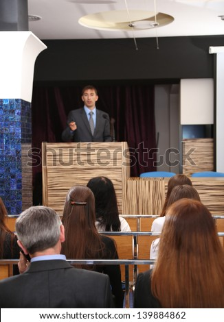 Business man is making a speech at conference room - stock photo