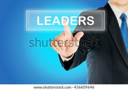 Business man is pushing LEADERS transparent button word over blue gradient background, business concept