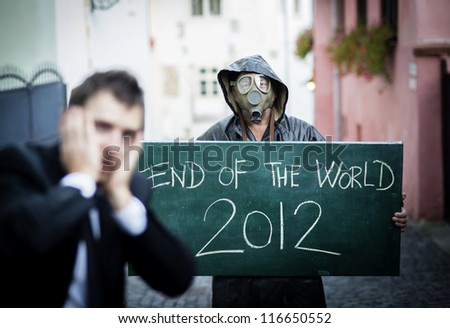 Business man is scared of the end of the world - stock photo