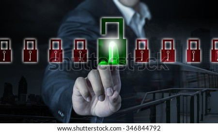 Business man is unlocking a virtual lock ,Business concept and technology background - stock photo