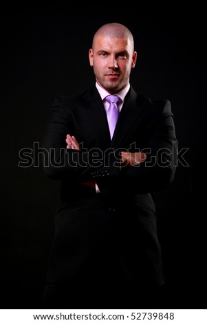 business man isolated on black - stock photo