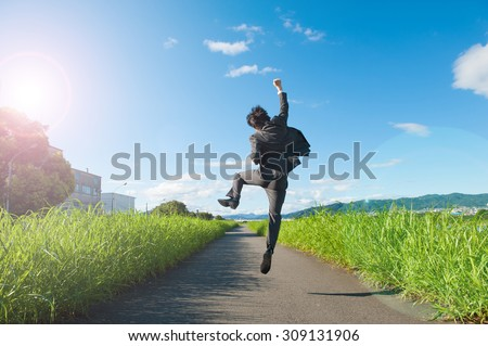 business man jump with blue sky, full length, asian male - stock photo