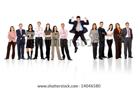 business man jumping with his business team formed of young businessmen and businesswomen standing over a white background with reflections - stock photo