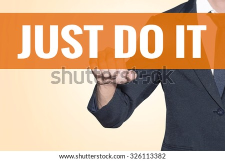 Business man Just Do It word touch on virtual screen orange background - stock photo